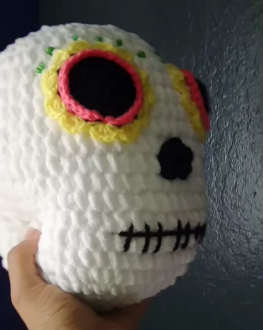 A work in progress....A giant sugar skull, made with @yarnspirations Baby Blanket yarn, it's so soft and squishy. It's like a decorative pillow..It measures about 8.5inches tall and almost 8 inches across..🏵️I will be adding flowers and more details later today. ️️☠️.I love it!!! And! I am super excited to make more to share with you. Who wants one!?Tag a friend that needs one. I will be taking orders soon. 🖤.This gorgeous Pattern is by @w0nderla1ne..#sugarskull #diadelosmuertos#dayofthedead #skull #creepycute #offerings #dayofthedeadskull #diadelosmuertosart #crochetskull #giftideas #crochetwip #amigurumilove #babyyarn #calavera #sacramento #muertos #diadelosmuertos #catrina #lacatrina #vivalosmuertos #vivafrida